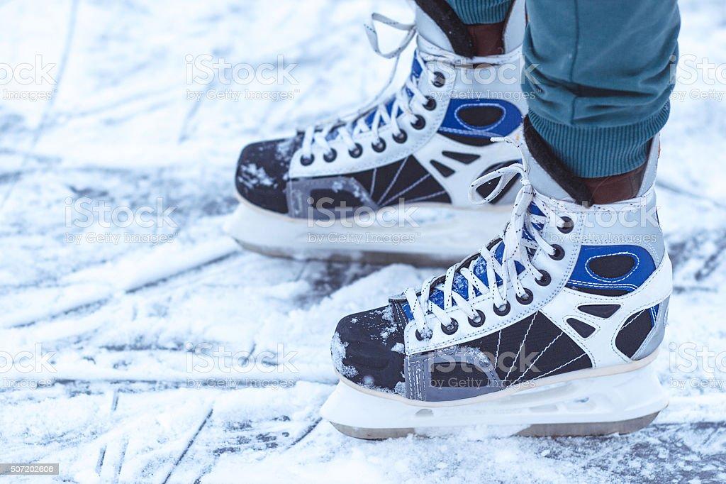 the sports hockey skates on ice stock photo