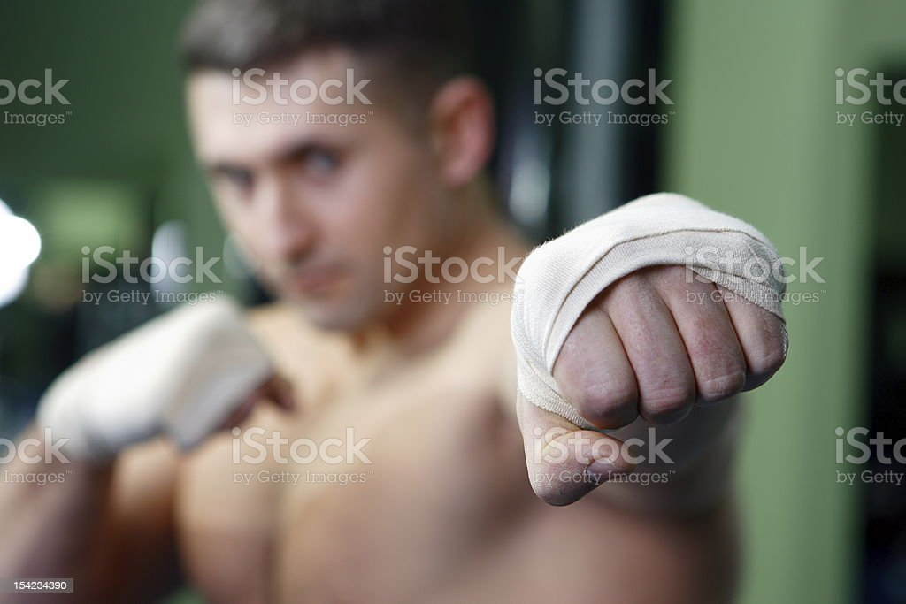 The sportsman trains in a gym royalty-free stock photo