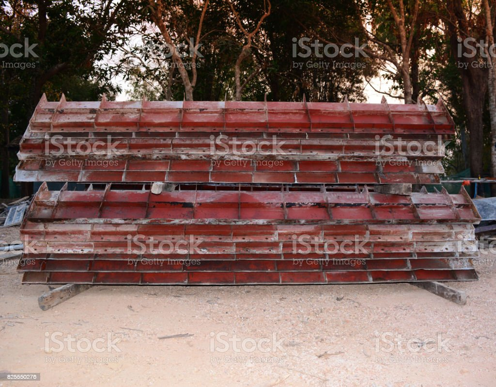 the stack of iron templates and some tool  in construction site stock photo