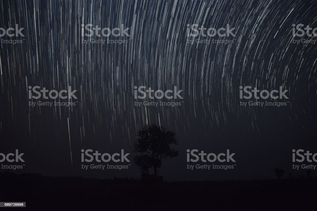 The star trail during the night  with gain and soft focus stock photo