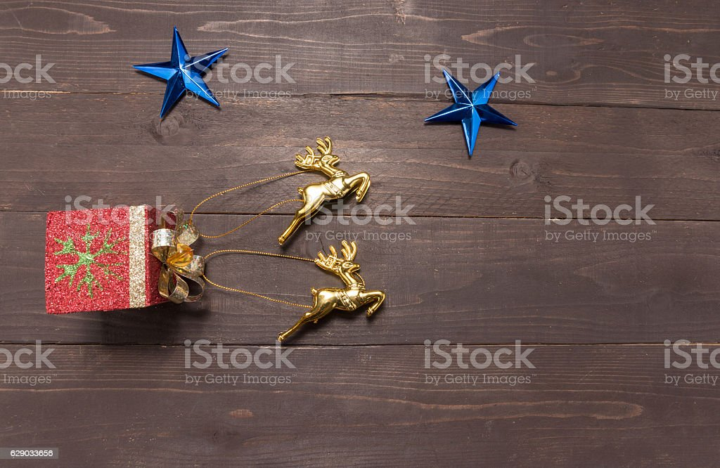 The stars and reindeers are on on the wooden background stock photo