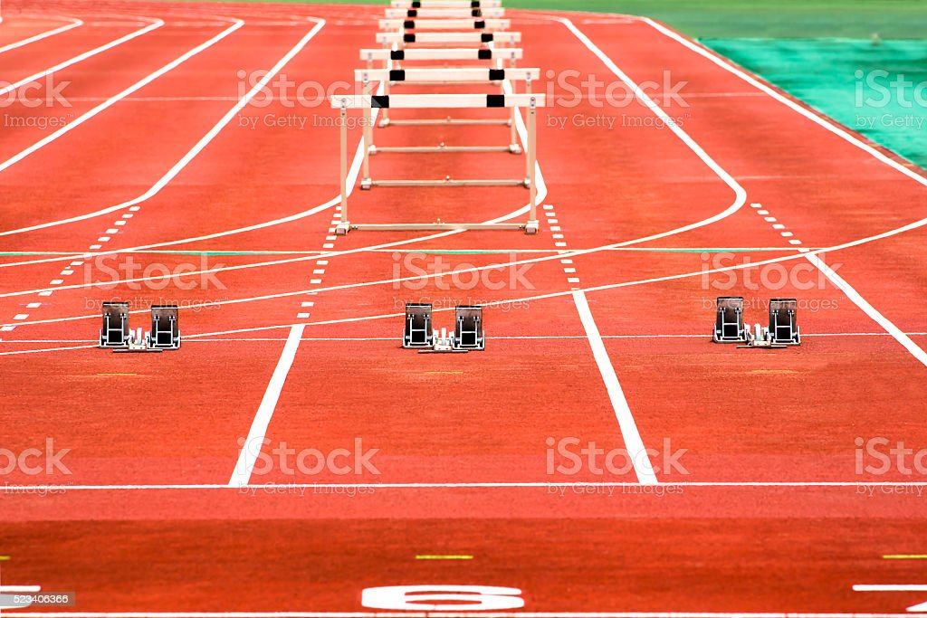 The starting block of the high-hurdle race stock photo