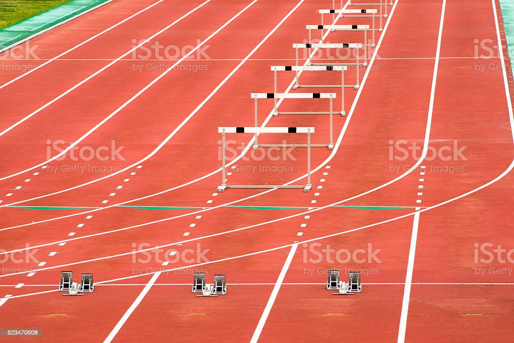 The starting blocks and the hurdles stock photo