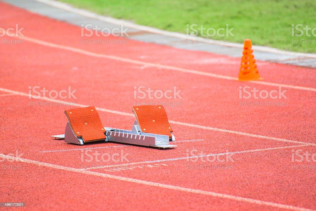 the starting blocks on running tracks stock photo