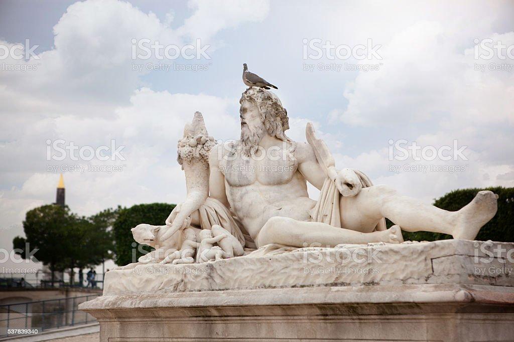 The statue Le Tibre in Tuileries Garden in Paris. stock photo
