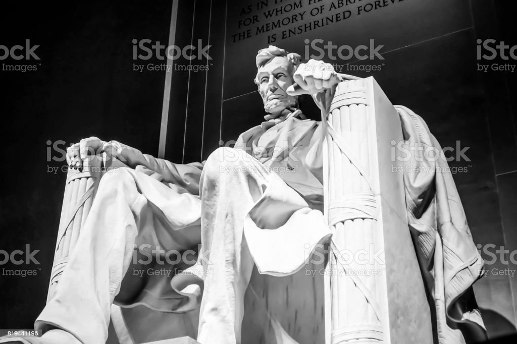 The statue of Abraham Lincoln sitting in a chair at Lincoln Memorial in Washington stock photo