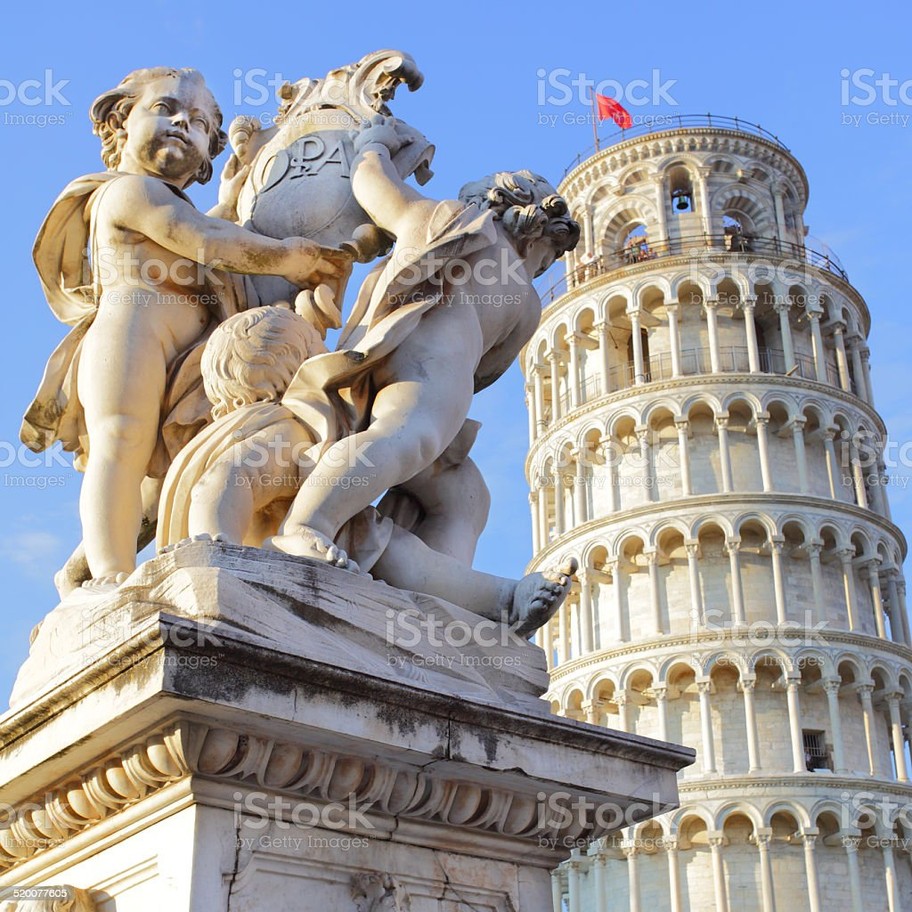 The statue of angels and Leaning Tower stock photo