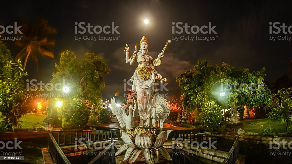 The Statue of Goddess Saraswati with Full Moon Background stock photo
