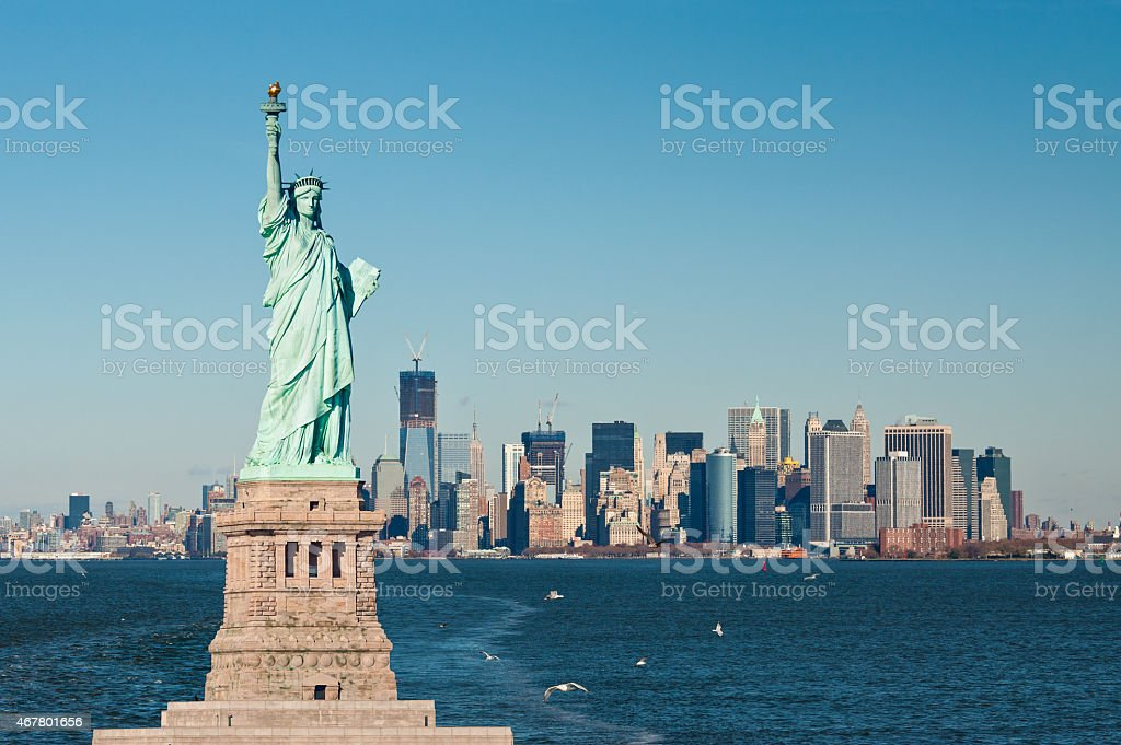 The statue of liberty against the New York City skyline stock photo