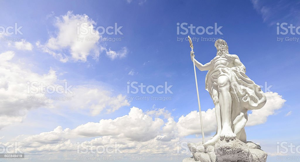 The statue of Poseidon and clear blue sky stock photo