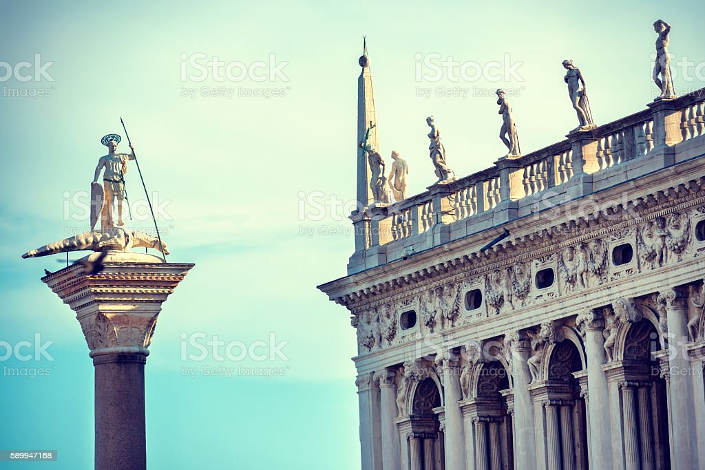 The statue of St. Theodore and Doge's Palace in Venice stock photo