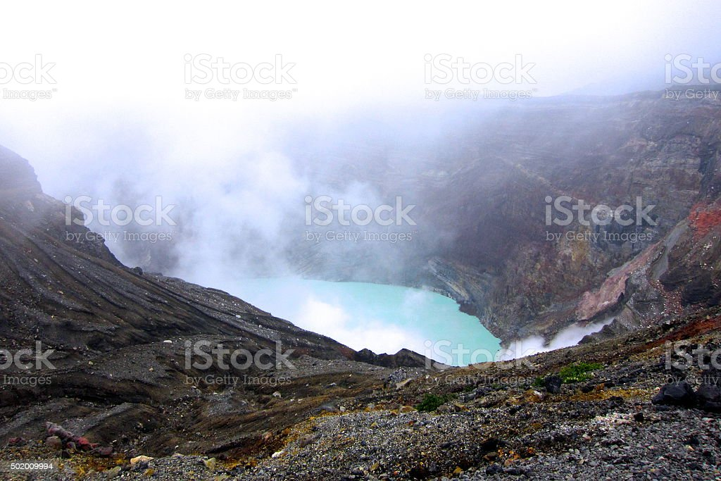 The steaming crater of Mountain Aso stock photo