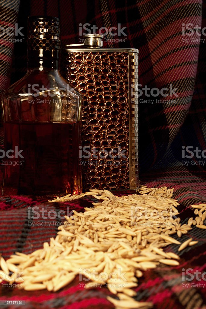 The still life with scotland whiskey bottle and flask royalty-free stock photo