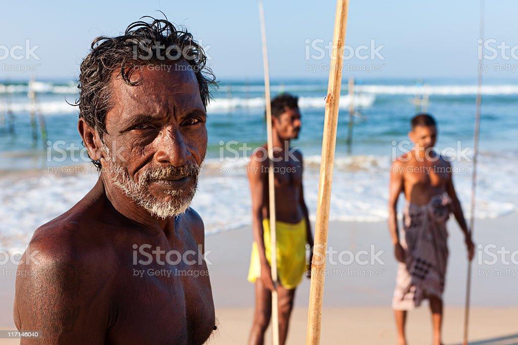 The stilt fishermen at work, Sri Lanka, Asia royalty-free stock photo