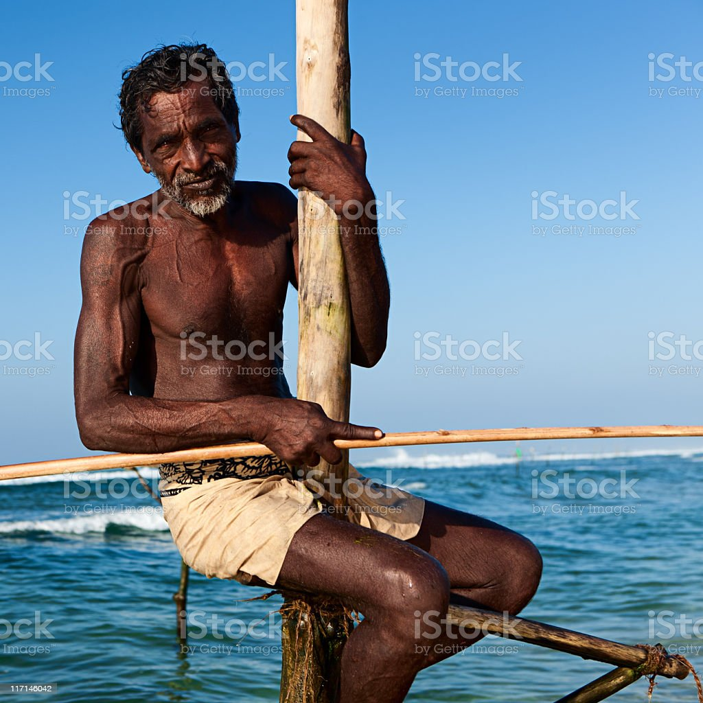 The stilt fishermen at work, Sri Lanka, Asia. royalty-free stock photo