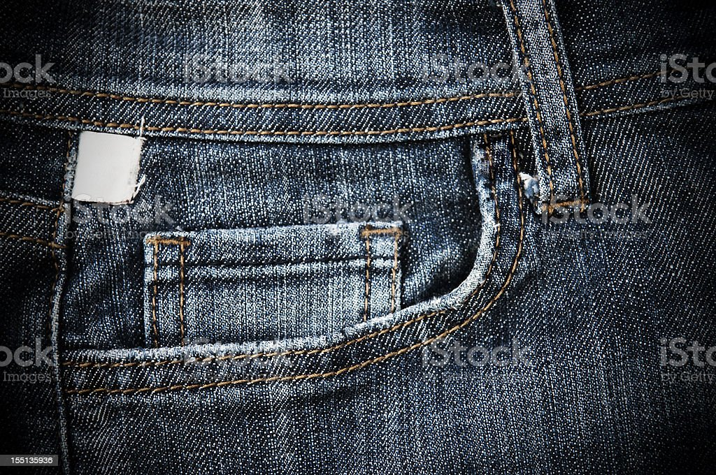 The stitched front pocket of a pair of denim jeans stock photo