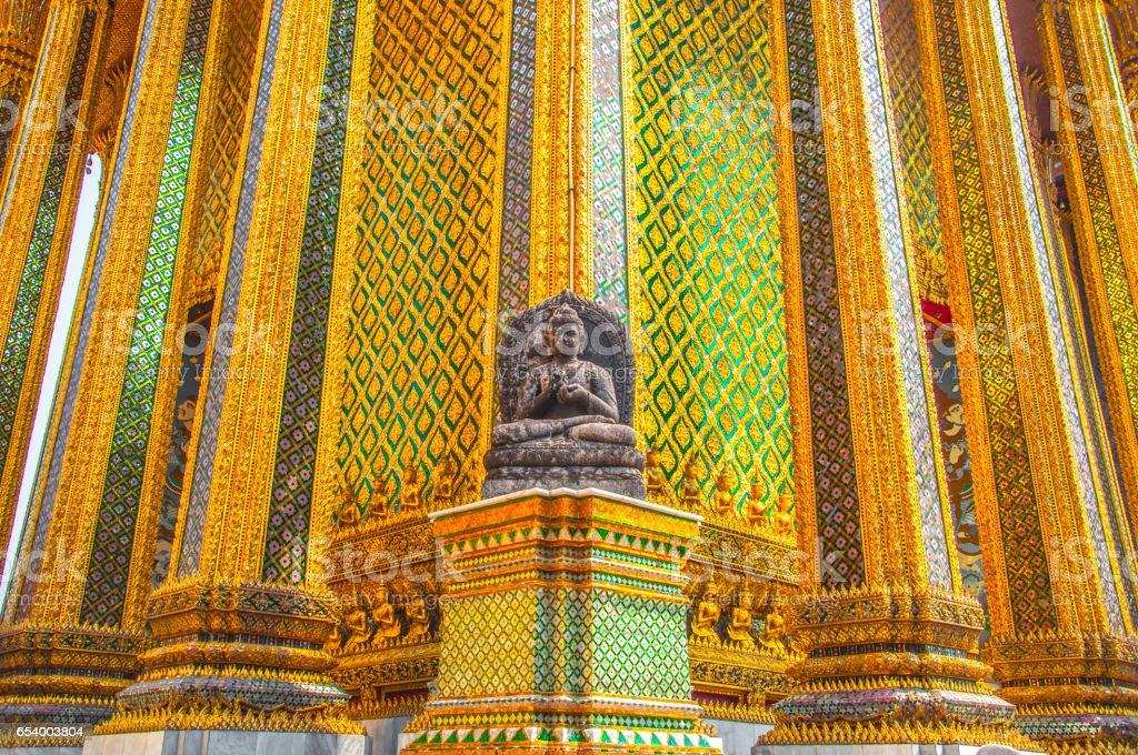 The Stone Buddha statue at Wat Phra Kaew, Royal Grand Palace, Bangkok, Thailand. stock photo