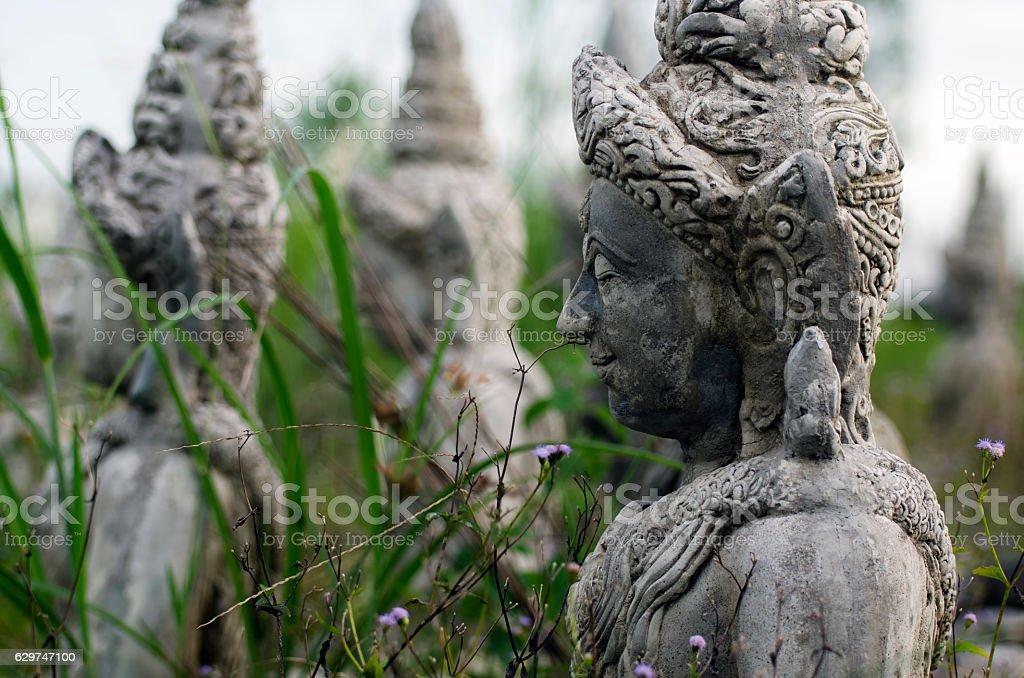 The stone statue of a Buddha at Sa Kaeo; Thailand. stock photo