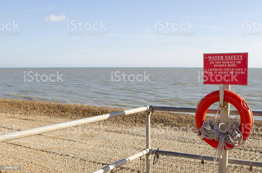 The stoney beach at Hythe in Kent, life belt preserver royalty-free stock photo