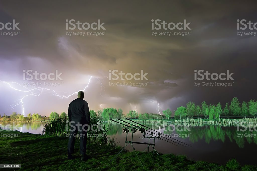 The storm is coming. Man standing in a storm. stock photo