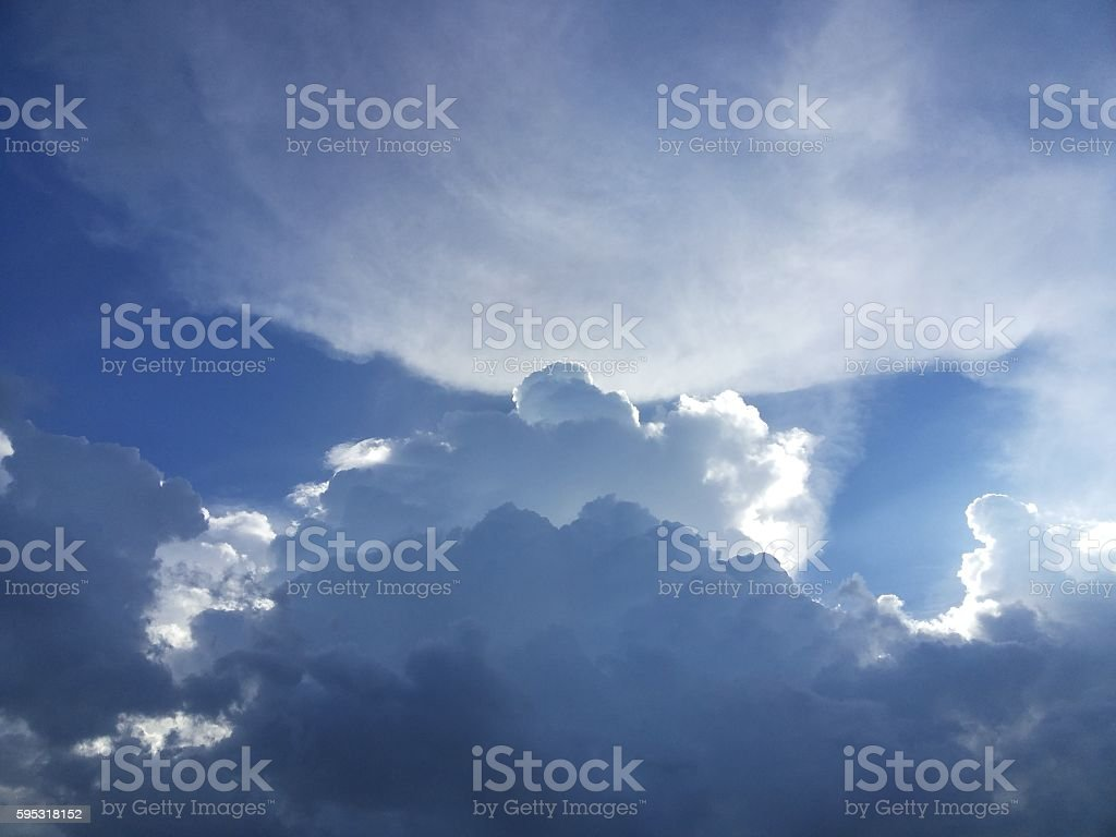 The Streamer shot out from behind large cloud stock photo