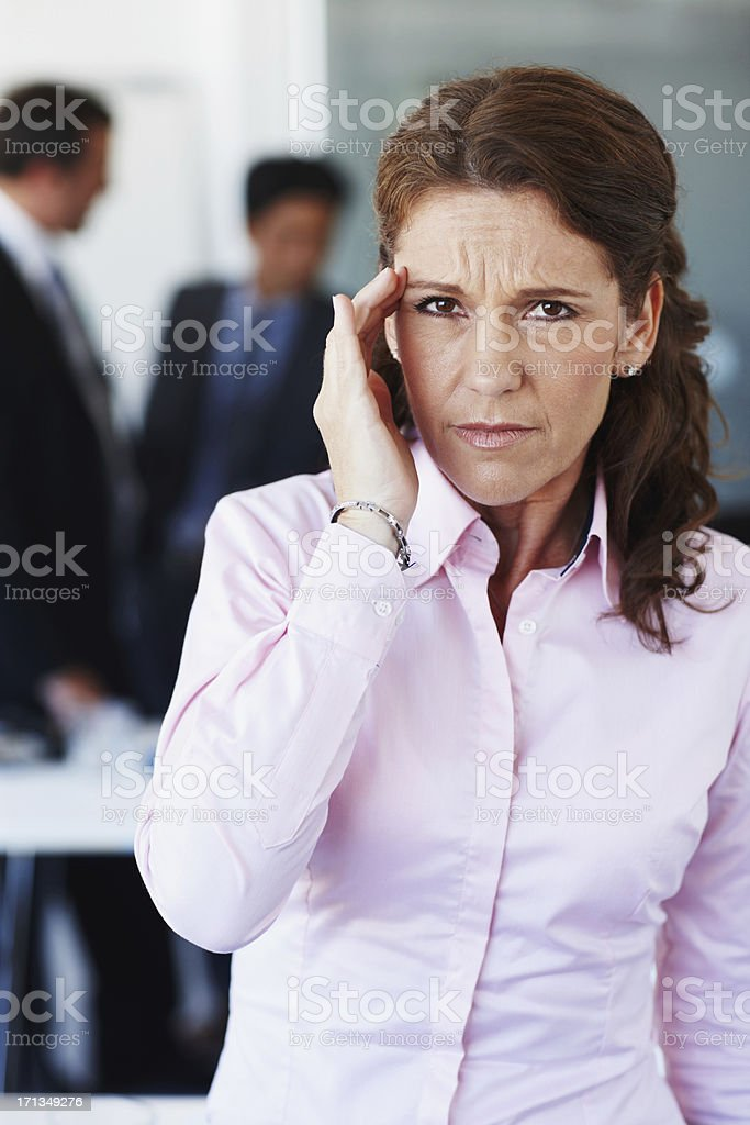 The stress of work is catching up to her stock photo
