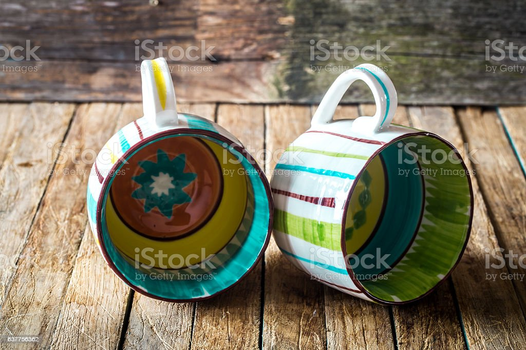 The striped Cup on wooden background stock photo