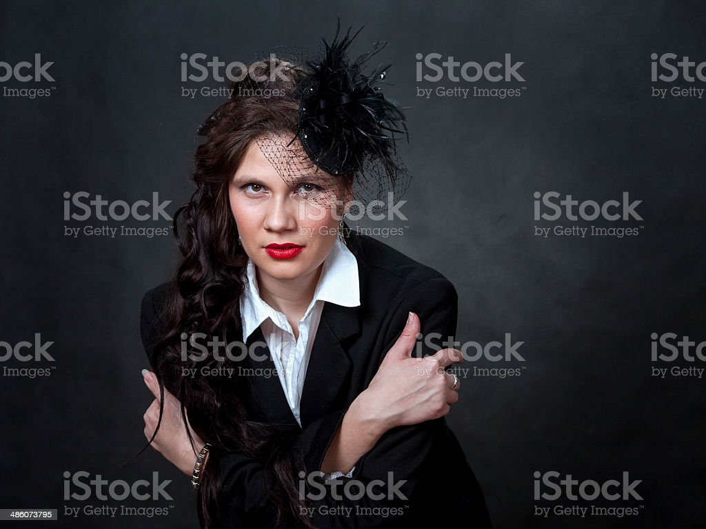 The stylish girl in a hat with a veil. stock photo