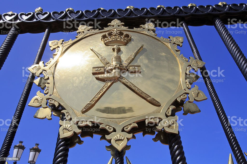 The Sultan's coat of arms on a brass shield royalty-free stock photo