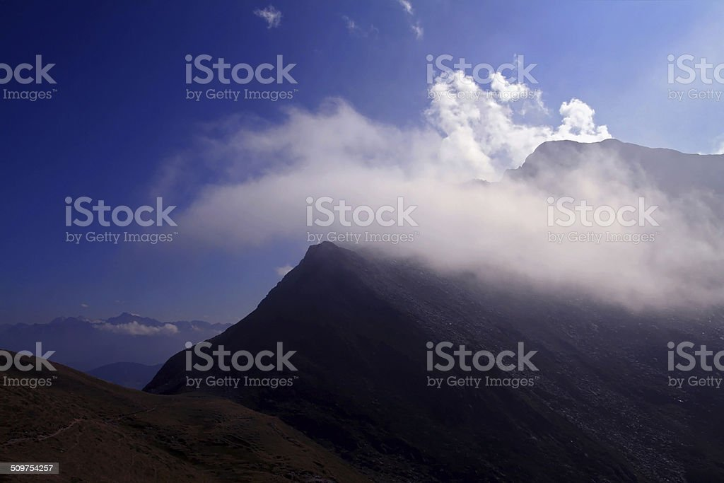 the summit in clouds stock photo