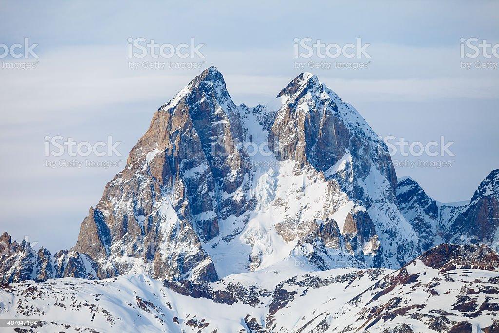 The summit of mount Ushba in the Caucasus range stock photo