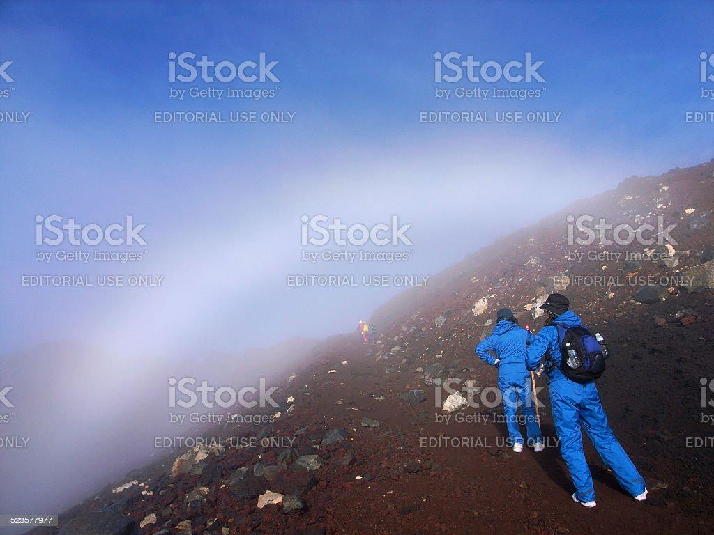 The summit of Mt.Fuji with Brocken spectre stock photo