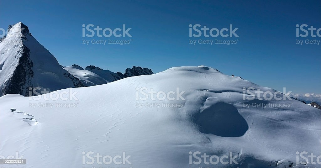 The summit of Tete Banche and Dent d'Herens stock photo