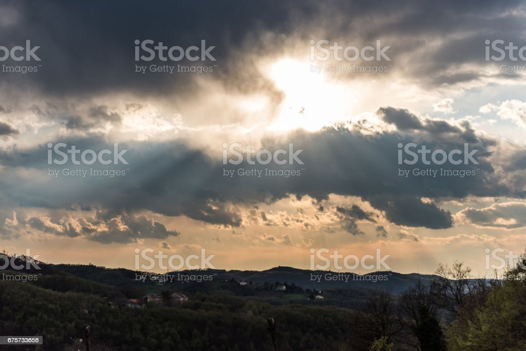 The sun behind the clouds stock photo