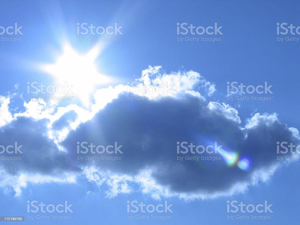 The Sun Breaks in a Tungsten Blue Sky #2 royalty-free stock photo