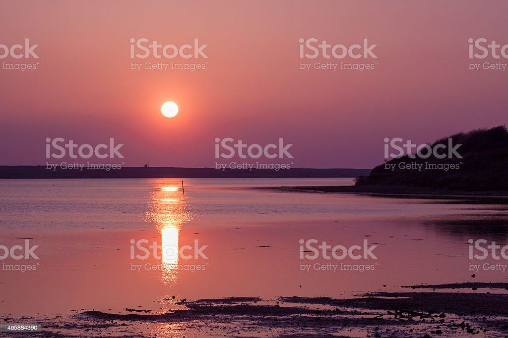 The sun goes down over the East Fleet in Dorset stock photo