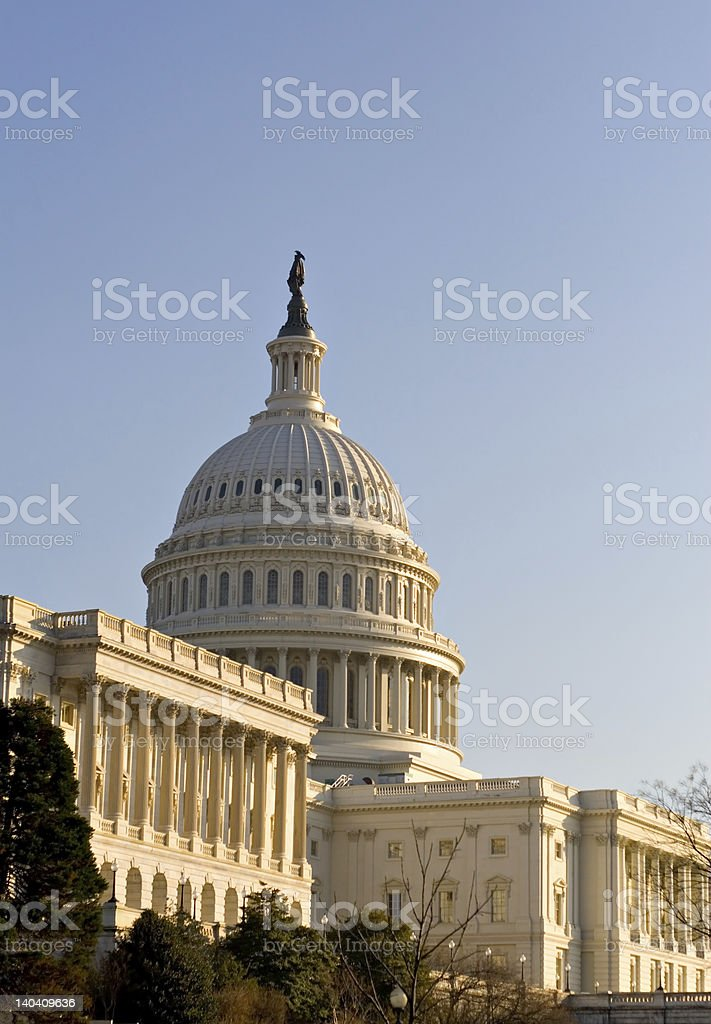 The sun hitting the U.S. Capitol in West Facade royalty-free stock photo