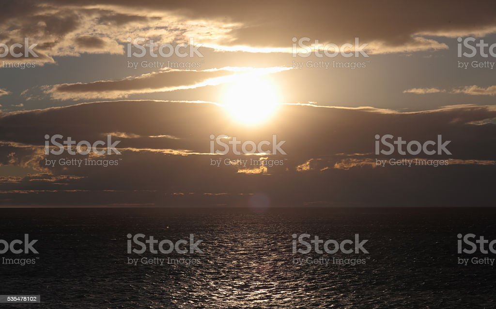 The Sun its down setting on Kaikoura Beach, New Zealand stock photo