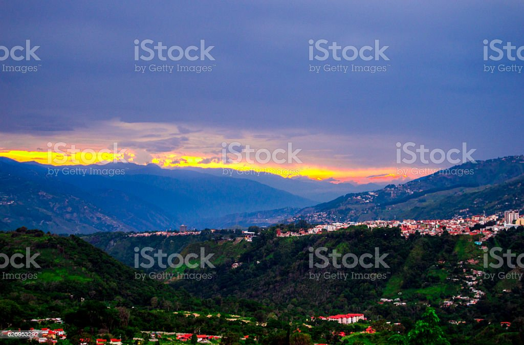 The sun line  above the clouds,with green Mountain(City) stock photo