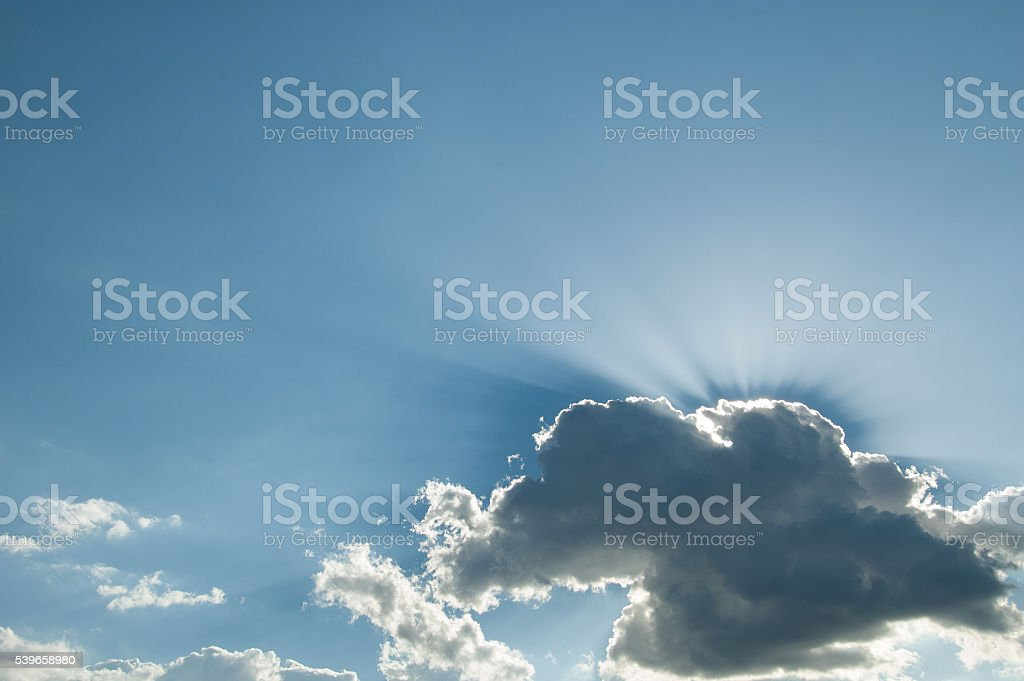 The Sun makes a silver lining stock photo