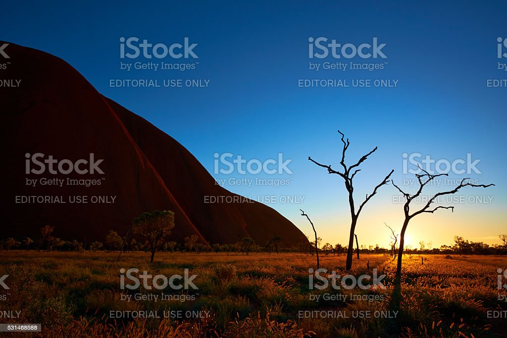 The Sun Rises At Uluru stock photo