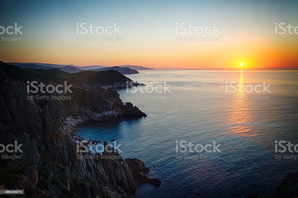 The sun rises over the Cape by name Lesuchenko. stock photo