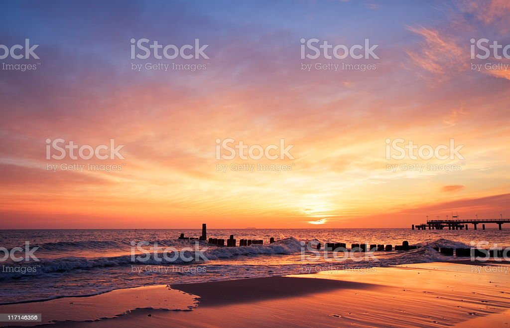 The sun rising at the beach in the morning royalty-free stock photo