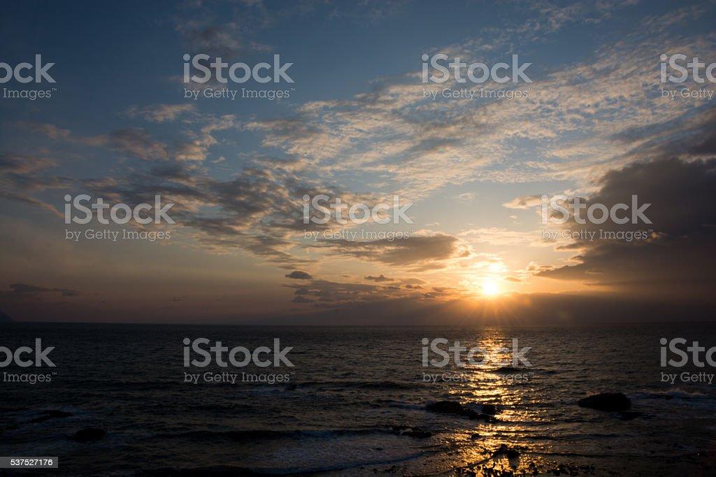 The sun set over the sea stock photo