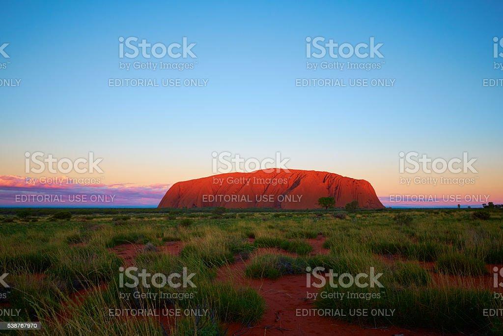 The Sun Sets On Uluru stock photo