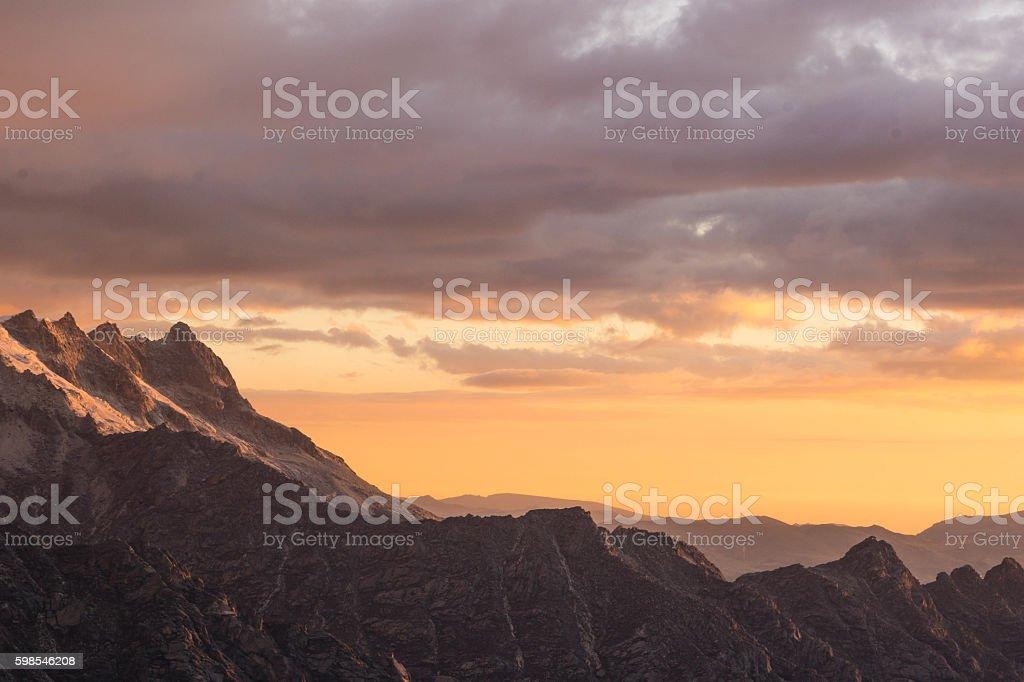 the sun sets over the Cordillera Blanca stock photo