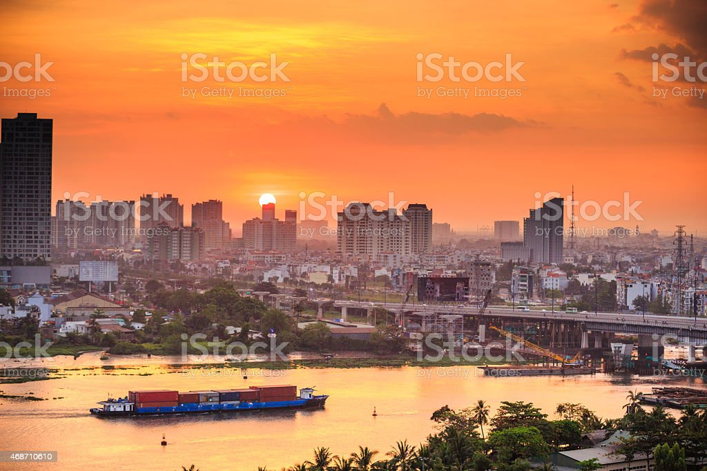 The sun setting behind the city of Saigon stock photo