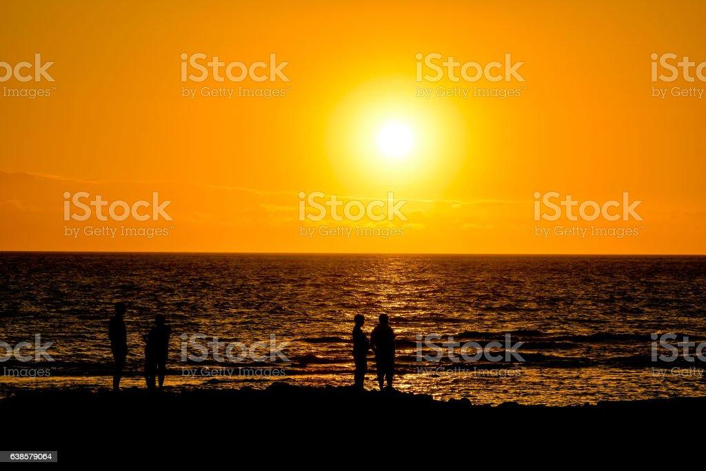 The  Sun Setting in the Sea stock photo