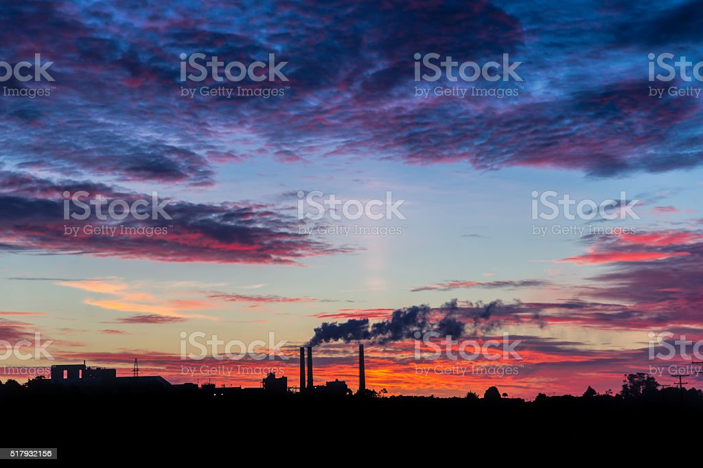 The sun setting over Westport Lime factory stock photo