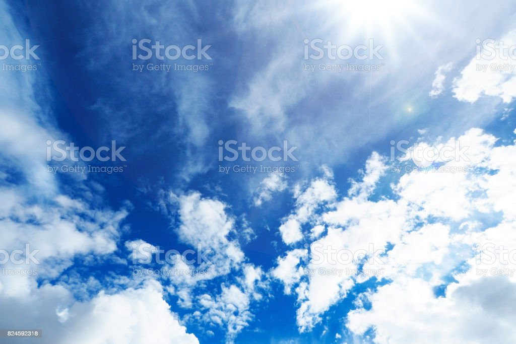 The sun shines bright in the daytime in summer. Blue sky and clouds. stock photo